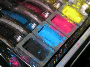 Why is my printer consuming color inks when printing black
